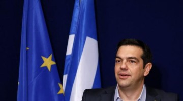 Greek PM Tsipras addresses a news conference after a EU leaders summit in Brussels