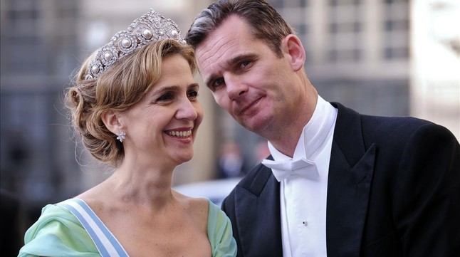 FILES  A file picture taken on June 19  2010 shows Infanta Cristina of Spain  L  and her husband Inaki Urdangarin arriving at the wedding banquet of newly-wed Swedish royal couple  Crown Princess Victoria and her husband Daniel Westling at the Royal Palace of Stockholm  A smiling  educated  mother-of-four who was madly in love with her dashing husband  Infanta Cristina had it all until a royal fraud scandal saw her plunge from Spanish darling to national  baddie   Cristina  the sister of King Felipe VI  and her husband  former Olympic handball player Inaki Urdangarin  will go on trial on January 11  2016 for corruption in a high stakes case that risks inflicting further damage to the image of the Spanish monarchy     AFP PHOTO  ATTILA KISBENEDEK    TO GO WITH AN AFP STORY BY LAURENCE BOUTREUX